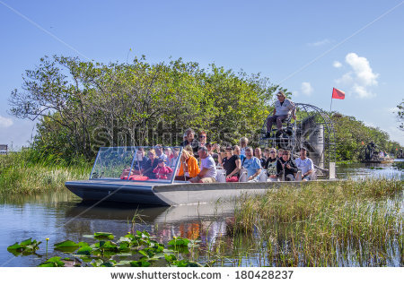 stock-photo-everglades-united-states-november-group-of-tourists-riding-an-airboat-the-everglades-180428237